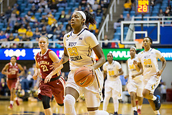 West Virginia Mountaineers guard Bria Holmes (23) drives on a fast break against the Oklahoma Sooners during the second half at the WVU Coliseum.
