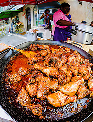 Food being cooked in the Place de l'Eglise, Issigeac, France on Bastille Day - 14th July<br /> <br /> (c) Andrew Wilson | Edinburgh Elite media