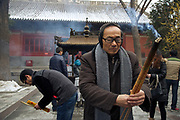Master Li prays in a temple in Luoyang Henan province, China