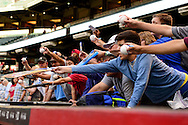 Apr 29, 2016; Phoenix, AZ, USA; Fans wait for autographs above the dugout prior to the MLB game between the Colorado Rockies and Arizona Diamondbacks at Chase Field. Mandatory Credit: Jennifer Stewart-USA TODAY Sports