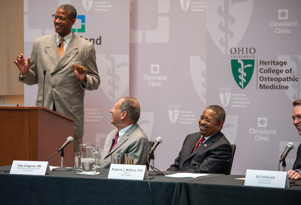 Ohio University President Dr. Roderick McDavis (Right Center) and Cleveland Clinic CEO Dr. Toby Cosgrove (Left Center) react to a comment by Warrensville Heights Mayor Bradley Sellers at a press conference at Southpointe Hospital.