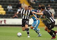 Photo: Leigh Quinnell.<br /> Notts County v Wycombe Wanderers. Coca Cola League 2. 12/08/2006. Notts County Andy Parkinson keeps the ball away from Wycombes Matt Bloomfield.