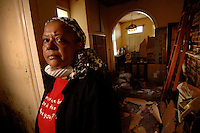 """I could just cry."" ..New Orleans resident Earline Melton's home was destryoed not by high floodwaters, but damage and leaks from her roof.  (Robert Caplin/New York Times)"