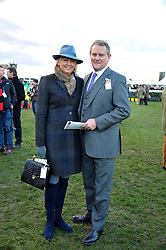 HUGH BONNEVILLE and his wife LULU at the 2012 Hennessy Gold Cup at Newbury Racecourse, Berkshire on 1st December 2012