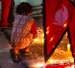 20th September 2015<br /> Today, after a decade of revision, amendment and debate, Nepal president Ram Baran Yadav announces the adoption of the long awaited constitution. <br /> Thousands of Nepalis come on to the streets inThamel, Kathmandu. Here a young girl lights a candle in celebration.