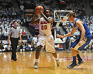 "Ole Miss' Nick Williams (20) vs. Kentucky's Jarrod Polson (5) at the C.M. ""Tad"" Smith Coliseum on Tuesday, January 29, 2013.  (AP Photo/Oxford Eagle, Bruce Newman).."