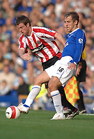 Photo: Paul Greenwood.<br />Everton v Sheffield United. The Barclays Premiership. 21/10/2006. Michael Tonge, left, battles with Everton's Phil Neville.