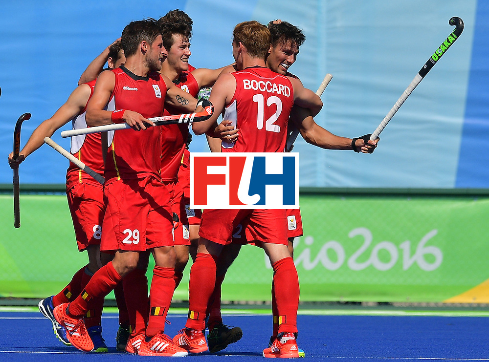 Belgium's Simon Gougnard (R) celebrates scoring a goal with teammates during the men's field hockey Belgium vs Britain match of the Rio 2016 Olympics Games at the Olympic Hockey Centre in Rio de Janeiro on August, 6 2016. / AFP / Carl DE SOUZA        (Photo credit should read CARL DE SOUZA/AFP/Getty Images)