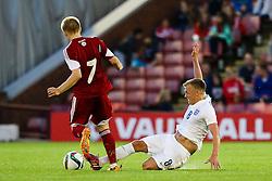 James Ward-Prowse of England wins a slide tackle - Photo mandatory by-line: Matt McNulty/JMP - Mobile: 07966 386802 - 11/06/2015 - SPORT - Football - Barnsley - Oakwell Stadium - England U21 v Belarus U21 - International Friendly U21s