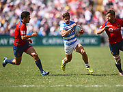 Argentina player Rodrigo Etchart finds a gap in the Spanish defence in the game Argentina vs Spain during the Cathay Pacific/HSBC Hong Kong Sevens festival at the Hong Kong Stadium, So Kon Po, Hong Kong. on 8/04/2018. Picture by Ian  Muir.