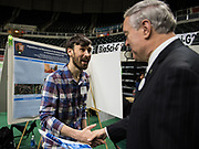 Austin Waag shakes Duane Nellis' hand after being awarded a 1st place ribbon.