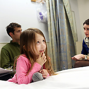 "Bellagrace Hurley, 4, came to the emergency room with dental pain. Here, her parents Chelsea and Jesse Fipps consult with patient guide Hannah Lobingier...""Typically, an ER is a Band-Aid on a condition; a car accident or some other trauma. But we're trying to see the whole picture of the patient. It's a real culture change. A lot of patients we see have never been told they have options in their care. A patient who comes in to the ER with a sore throat or ingrown toenail may not know how they can go to a community partner clinic or urgent care setting and save thousands of dollars."" - Hannah Lobingier...Hannah Lobingier and other patient guides in the emergency department at Providence St. Vincent Medical Center in Portland, Ore., are part of a new grant-based program in the Health Share CCO. Many people who come to the emergency room would be more appropriately served in less-expensive settings, and patient guides such as Lobingier act as advocates to help find these patients the appropriate care."