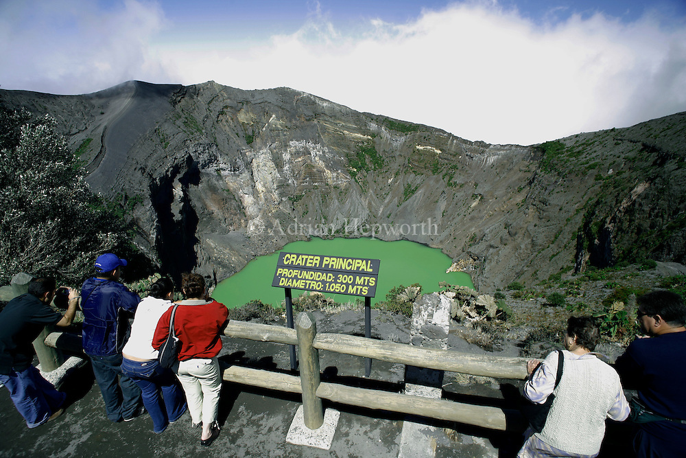 Tourists looking at active crater of Irazu Volcano, Costa Rica.<br /> <br /> For pricing click on ADD TO CART (above). We accept payments via PayPal.