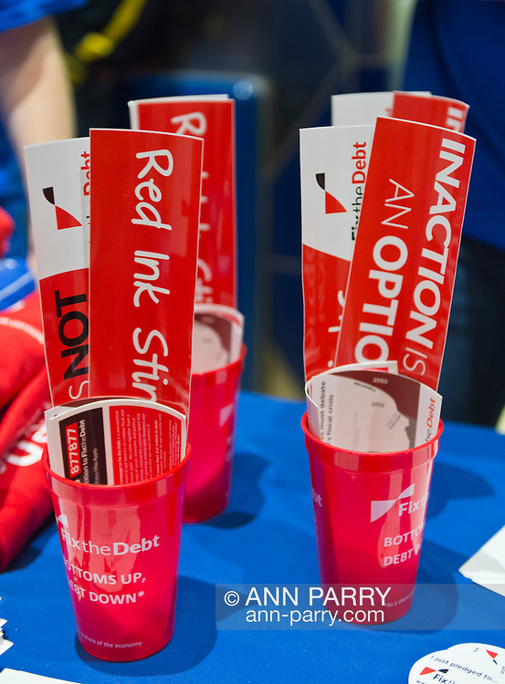 "Oct. 15, 2012 - Hempstead, New York, U.S. - Fix the Debt Campaign stickers with ""Red Ink Stinks"" slogan and more are on table in lobby of Hofstra University's John Cranford Adams Playouse, while the campaign's co-founders, Simpson and Bowles, speak in the auditorium about ?America's Debt and Deficit Crisis: Issues and Solutions.? This event with the co-chairmen of the National Commission on Fiscal Responsibility and Reform, and co-leaders of Simpson-Bowles non-partisan U.S. fiscal debt reduction plan, was part of ""Debate 2012 Pride Politics and Policy"" a series of events leading up to when Hofstra hosts the 2nd Presidential Debate between Obama and M. Romney, the next night, October 16, 2012, in a Town Meeting format."