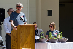 10 May 2014:  Normal Mayor Chris Koos at podium for 25th anniversary celebration of the Constitution Trail ceremony at Connie Link Amphitheater in Normal Illinois