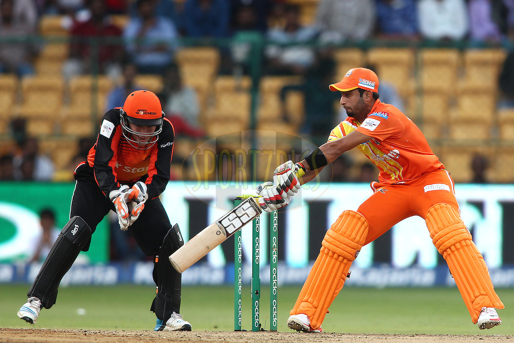 Saad Naseem of the Lahore Lions square cuts a delivery during match 19 of the Oppo Champions League Twenty20 between the Perth Scorchers and the Lahore Lions held at the M. Chinnaswamy Stadium, Bengaluru, India on the 30th September 2014<br /> <br /> Photo by:  Shaun Roy / Sportzpics/ CLT20<br /> <br /> <br /> Image use is subject to the terms and conditions as laid out by the BCCI/ CLT20.  The terms and conditions can be downloaded here:<br /> <br /> http://sportzpics.photoshelter.com/gallery/CLT20-Image-Terms-and-Conditions-2014/G0000IfNJn535VPU/C0000QhhKadWcjYs