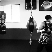 Abner works the bags at Maywood Boxing Club in Los Angeles.