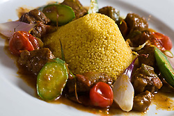 Cuscuz de Farinha Ovinha, Cabrito Guisado e Legumes do Restaurante Tordesilhas. / Couscous or kuskus, made with the cassava flour, goat and vegetables. The Tordesilhas Restaurant is a great Brazilian cuisine in Sao Paulo