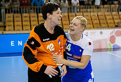 Sergeja Stefanisin and Ana Petrinja of Slovenia celebrate after the handball match between Women National teams of Slovenia and Serbia in 2nd Round of Qualifications for 2014 EHF European Championship on October 27, 2013 in Hala Tivoli, Ljubljana, Slovenia. Slovenia defeated Serbia 31-26. (Photo by Vid Ponikvar / Sportida)