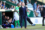 Yeovil Town manager Darren Way watching the game as Yeovil Town's Leroy Lita prepares to come on as a substitute during the Sky Bet League 2 match between Yeovil Town and Carlisle United at Huish Park, Yeovil, England on 25 March 2016. Photo by Graham Hunt.