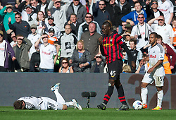 SWANSEA, WALES - Sunday, March 11, 2012: Manchester City's Mario Balotelli in action against Swansea City during the Premiership match at the Liberty Stadium. (Pic by David Rawcliffe/Propaganda)