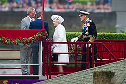 © Licensed to London News Pictures. 03/06/2012. London, UK. HRH The Queen boarding the Royal Barge Spirit of Chartwell with Prince Phillip during the Jubilee Pageant on the River Thames, London on June 03,2012 as part of The Diamond Jubilee celebrations. Great Britain is celebrating the 60th  anniversary of the countries Monarch HRH Queen Elizabeth II accession to the throne . Photo credit : Ben Cawthra/LNP