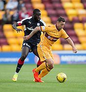 Motherwell&rsquo;s Scott McDonald and Dundee&rsquo;s Kevin Gomis - Motherwell v Dundee in the Ladbrokes Scottish Premiership at Fir Park, Motherwell. Photo: David Young<br />
