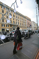 Woman carrying shopping bags in Rome Italy at Christmas time