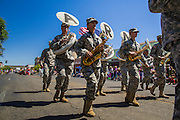 30 JUNE 2012 - PRESCOTT, AZ:  The Arizona Army National Guard marching band in the Prescott Frontier Days Rodeo Parade. The parade is marking its 125th year. It is one of the largest 4th of July Parades in Arizona. Prescott, about 100 miles north of Phoenix, was the first territorial capital of Arizona.    PHOTO BY JACK KURTZ