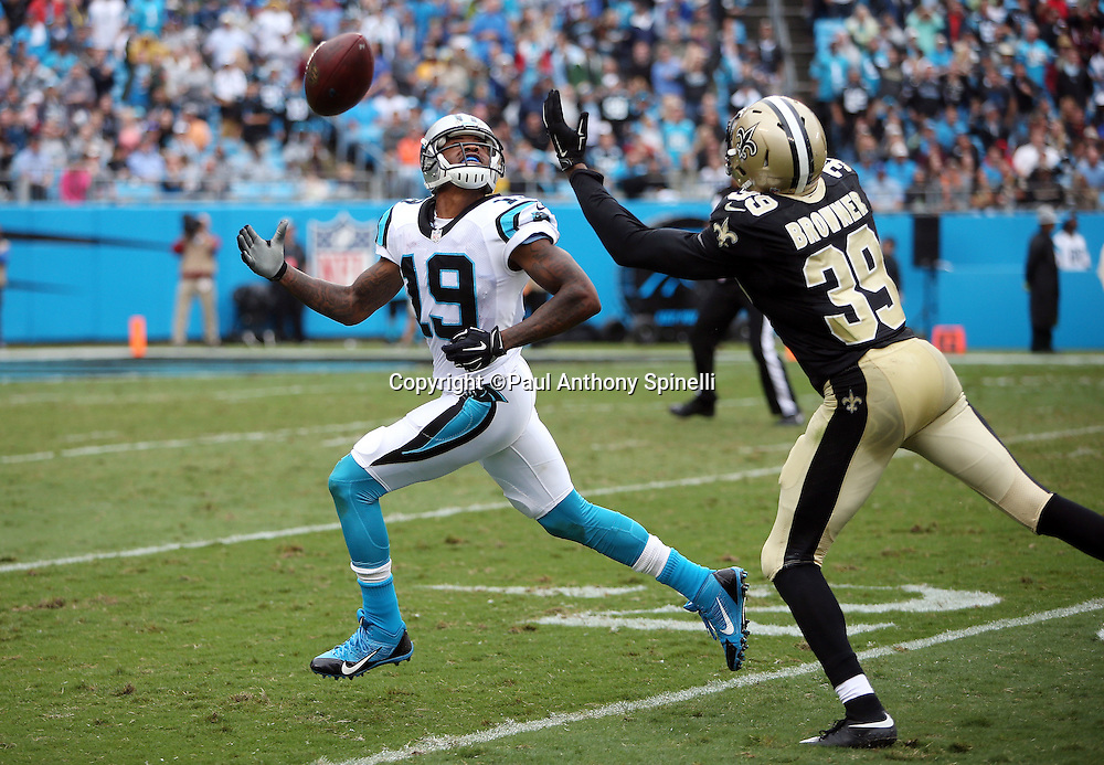 Carolina Panthers wide receiver Ted Ginn, Jr. (19) reaches for an incomplete pass while covered by New Orleans Saints cornerback Brandon Browner (39) during the 2015 NFL week 3 regular season football game against the New Orleans Saints on Sunday, Sept. 27, 2015 in Charlotte, N.C. The Panthers won the game 27-22. (©Paul Anthony Spinelli)