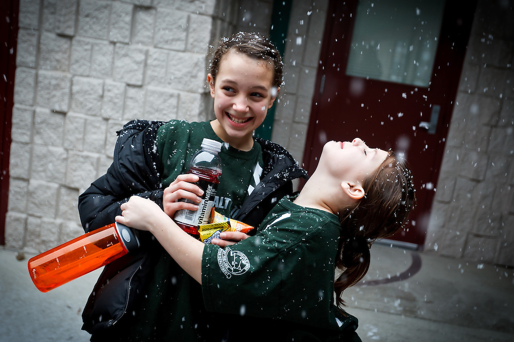 Rheana Pollos leans her head back to enjoy the falling snow Saturday, Dec. 18, 2010 while walking outside Fernan Elemenatary with her friend Julie Schoener after their last basketball game of the year.