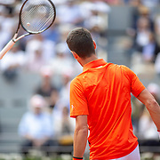 PARIS, FRANCE June 06. Novak Djokovic of Serbia throws his racquet during his match against Alexander Zverev of Germany on Court Philippe-Chatrier during the Men's Singles Quarter Final match at the 2019 French Open Tennis Tournament at Roland Garros on June 6th 2019 in Paris, France. (Photo by Tim Clayton/Corbis via Getty Images)