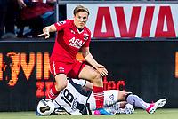 ALMELO - 14-04-2017, Heracles  Almelo - AZ, AFAS Stadion, AZ speler Jonas Svensson, Heracles Almelo speler Kristoffer Peterson