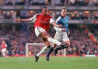 Thierry Henry drives the ball past Manchester City goalkeeper Nicky Weaver to score the 4th Arsenal goal. Arsenal v Manchester City, F.A.Carling Premiership, 28/10/2000. Credit Colorsport / Stuart MacFarlane.