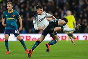 Hull City midfielder George Honeyman challenges Derby County midfielder Jason Knight during the EFL Sky Bet Championship match between Derby County and Hull City at the Pride Park, Derby, England on 18 January 2020.