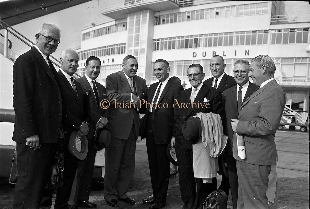 03/07/1963<br /> 07/03/1963<br /> 03 July 1963<br /> American executives of N.C.R. visit Dublin. Two top executives of the Dayton, Ohio, headquarters of the National Cash Register Company, one of the world's foremost manufacturers of cash registers, accounting machines and electronic computers, visiting Dublin. Picture shows Mr George Haynes (4th from left) Vice President International Operations N.C.R., Dayton Ohio, being welcomed on arrival at Dublin Airport by Mr W.R. Dooley, Manager for Ireland Accounting Machine Division N.C.R., also in the picture are Mr. D.K. Hughes, (2nd from right) Manager Overseas Factories, N.C.R.; Mr M.J. Toomey, (left) Special Sales Superintendent Aer Lingus; Mr S.J. Conway (2nd left) Managing Director, N.C.R. (Great Britain and Republic of Ireland); Mr D.H. Triggs, (3rd Left) Assistant Manager Accounting Machine Division N.C.R.; Mr W.R. Hart, (6th left) Director N.C.R. (Great Britain); Mr O.J. Byrne, (7th left) Manager for Ireland, Cash Register Division N.C.R. and Mr Jim Hughes (right) Special Sales Department Aer Lingus.