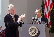US President Bill Clinton applauds incoming Chief of Staff John Podesta as he delivers remarks during a Rose Garden ceremony at the White House October 20, 1998 in Washington, DC. Clinton announced John Podesta as the new chief of staff replacing Erskine Bowles.