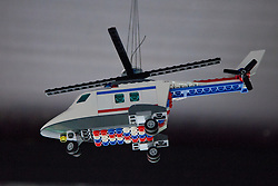 © Licensed to London News Pictures. 05/07/2012. London, UK. Minature LEGO Olympic helicopter from the Opening Ceremony of the Olympic Games flies from the ceiling above a replica of the Olympic stadium and Orbit. LEGO creator, Warren Elsmore used around 250,000 standard LEGO bricks to create a miniature replica of the London 2012 Olympic Games Park. The model took Warren, aged 35 from Edinburgh, 300 hours to construct and is on display at the 'Visit Denmark' Olympic Village  at St Katharine Docks, London. Photo credit : Vickie Flores/LNP