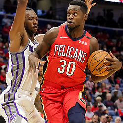Oct 19, 2018; New Orleans, LA, USA; New Orleans Pelicans forward Julius Randle (30) is defended by Sacramento Kings forward Harry Giles (20) during the first half at the Smoothie King Center. The Pelicans defeated the Kings 149-129. Mandatory Credit: Derick E. Hingle-USA TODAY Sports