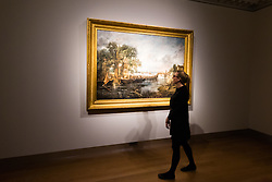 "Christie's, St James, London. A woman takes in the serene landscape as Christie's in London announce the sale of a work of genius by John Constable, the full scale six-foot ""sketch"" for ""View on the Stour near Dedham"" painted between 1821 and 1822, which is expected to fetch between £18-22 million at auction."