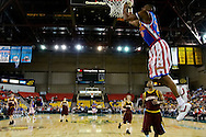 05 May 2006: High flier Kris Bruton (26) goes for a soaring dunk during the Harlem Globetrotters vs the New York Nationals at the Sulivan Arena in Anchorage Alaska during their 80th Anniversary World Tour.