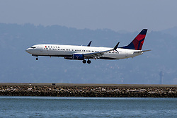Delta Boeing 737-932ER (N855DN) lands at San Francisco International Airport (SFO), Millbrae, California, United States of America