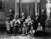King Chulalongkorn the Great (Rama V) of Siam, with his family. In this photo, Crown Prince Vajirunhis leans on his father's chair, while the future King Rama VI, Prince Vajiravudh, stands behind the queen's chair. It's not entirely clear which of Chulalongkorn's four queens is pictured here, but she most resembles Queen Saovabha Bongsri, the mother of Vajiravudh. Crown Prince Vajirunhis died unexpectedly at the age of 16 in 1894, so Chulalongkorn was succeeded by Vajiravudh instead in 1910.