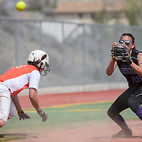040415       Cable Hoover<br /> <br /> Miyamura Patriot Martina Ortega (11) reaches for the ball in an attempt to pick off Aztec Tiger Kylie Brown (18) Saturday at Ford Canyon Park in Gallup.