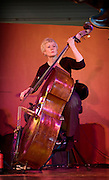 Bassist Alison Rayner using a bow on the double bass. Playing bass at the Deirdre Cartwright group during a performance in 2008 in the frontroom of the Southbank center in London.