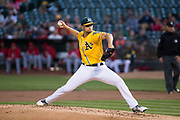 Oakland Athletics starting pitcher Kendall Graveman (49) pitches against the Los Angeles Angels at Oakland Coliseum in Oakland, California, on September 5, 2017. (Stan Olszewski/Special to S.F. Examiner)