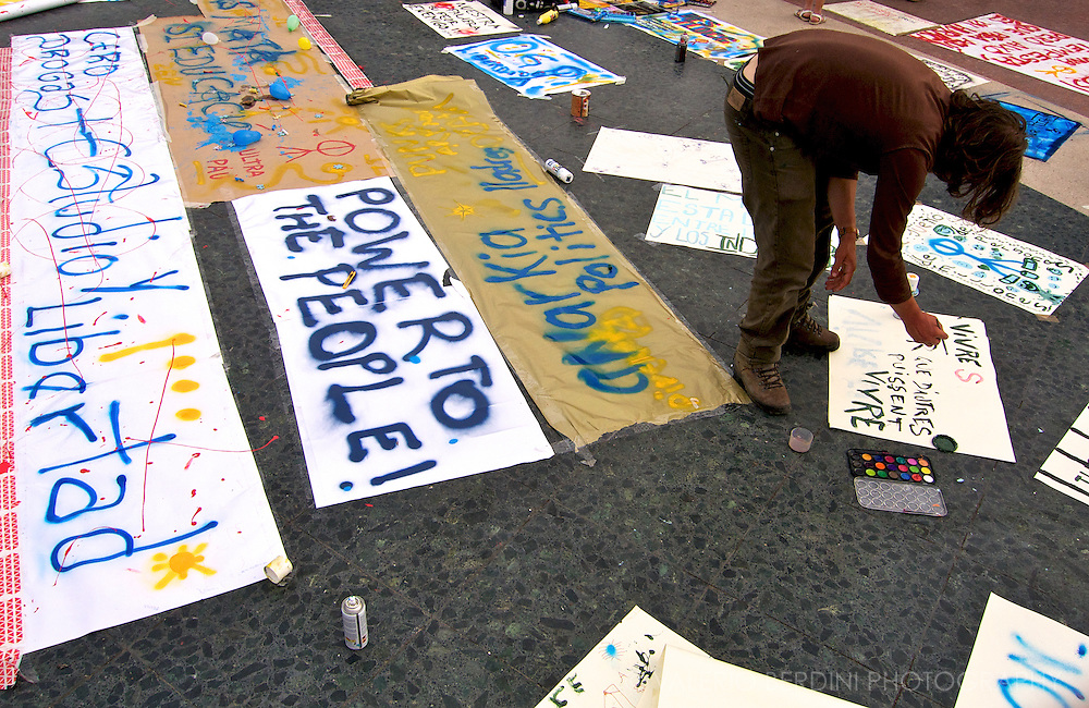 People filling up the entire square with hand painted banners.