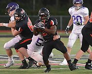 Hatboro-Horsham's Josh Smith (25) runs with the football as Upper Moreland defenders attempt to pull him to the ground in the first quarter Saturday, September 23, 2017 in Horsham, Pennsylvania. (Photo by William Thomas Cain)