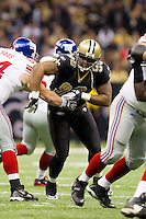 28 November 2011: Defensive tackle (96) Tom Johnson of the New Orleans Saints rushes the quarterback against the New York Giants during the first half of the Saints 49-24 victory over the Giants at the Mercedes-Benz Superdome in New Orleans, LA.