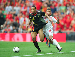 LONDON, ENGLAND - Saturday, June 2, 2012: England's Alex Oxlade-Chamberlain in action against Belgium's Moussa Dembele during the International Friendly match at Wembley. (Pic by David Rawcliffe/Propaganda)